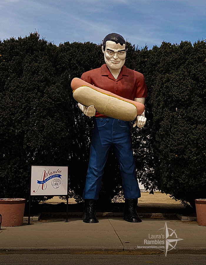 Paul Bunyan holding a hot dog