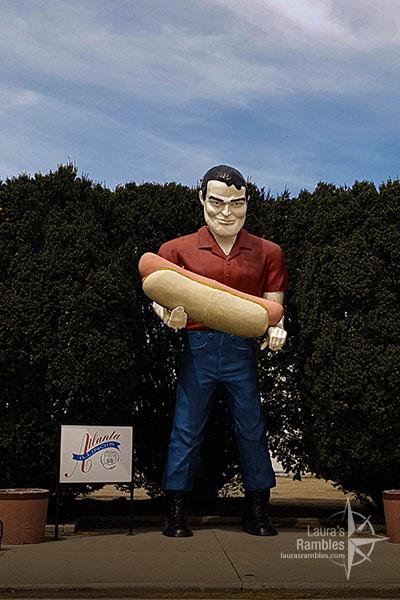 Paul Bunyan holding a hot dog