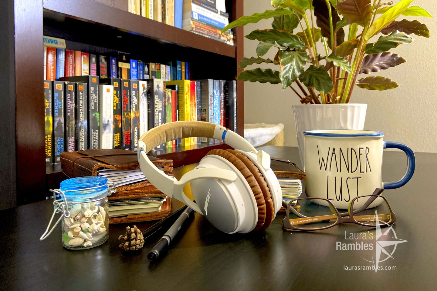Podcast feature image - headphones, travel journals, coffee, oh my